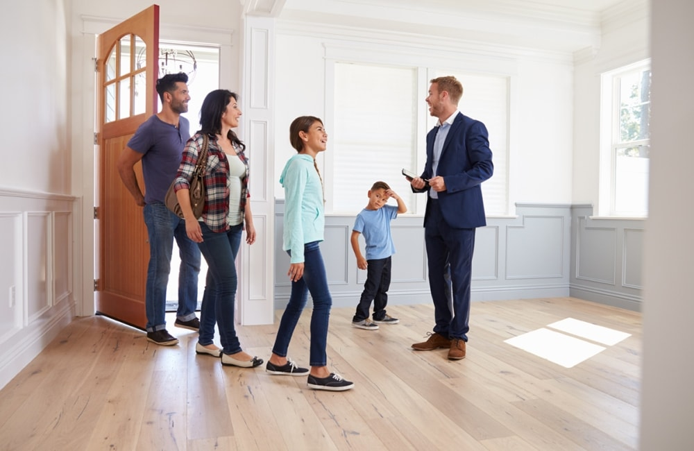 A family looking at a house being shown by a Clear Path REG Realtor