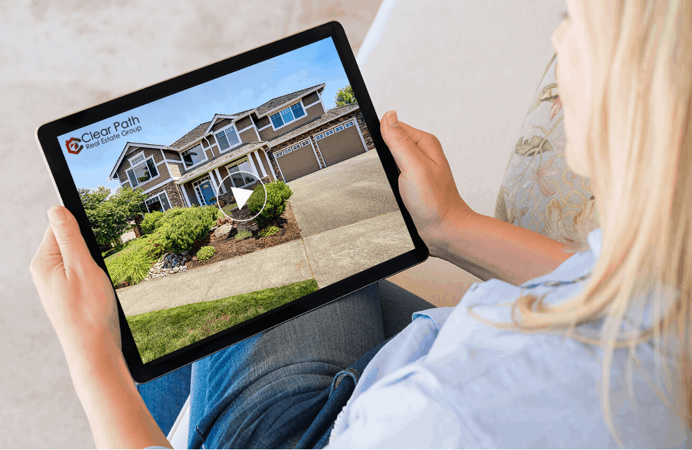 A woman watching a Real Estate Video on Tablet